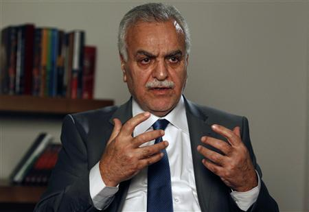 Iraq's fugitive Vice President Tareq al-Hashemi gestures during an interview with Reuters in Istanbul, September 16, 2012. Iran is using Iraqi airspace to fly supplies to Syrian President Bashar al-Assad's forces and thousands of Iraqi militia fighters have crossed into Syria to support his troops, al-Hashemi said on Sunday. REUTERS/Osman Orsal