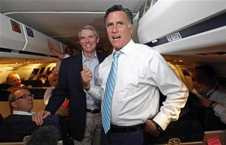U.S. Republican presidential nominee and former Massachusetts Governor Mitt Romney (R) is joined by Sen. Rob Portman (R-OH) on his campaign plane on their way to Bedford, Massachusetts, September 14, 2012. REUTERS/Jim Young