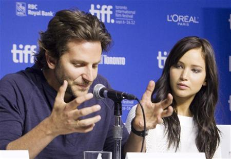 Actors Bradley Cooper (L) and Jennifer Lawrence attend a news conference to promote the film ''Silver Linings Playbook'' during the 37th Toronto International Film Festival September 9, 2012. REUTERS/Fred Thornhill