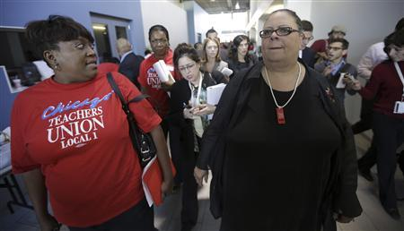 Chicago Teachers Union President Karen Lewis (R) leaves a press conference on the fifth day of their strike in Chicago, September 14, 2012. REUTERS/John Gress