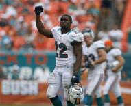 Miami Dolphins' Reggie Bush leaves the field after his team defeated the Oakland Raiders in their NFL football game in Miami Gardens, Florida September 16, 2012. REUTERS/Andrew Innerarity