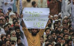 A supporter of the Jamaat-ud-Dawa Islamic organization holds up a placard while taking part with others in an anti-American rally in Lahore on September 16, 2012. About 4000 protesters gathered at a rally to condemn a film produced in the U.S. mocking the Prophet Mohammad. REUTERS/Mohsin Raza
