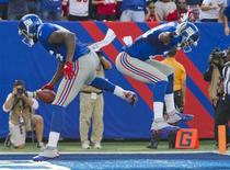 New York Giants tight end Martellus Bennett celebrates a touchdown against the Tampa Bay Buccaneers with wide receiver Ramses Barden (R) in the fourth quarter of their NFL football game in East Rutherford, New Jersey, September 16, 2012. REUTERS/Ray Stubblebine