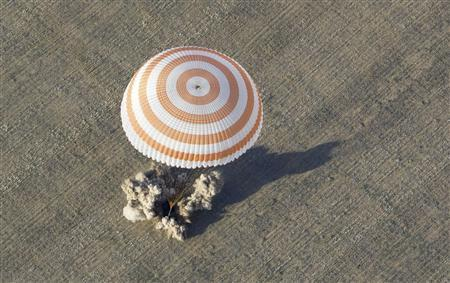 The Soyuz TMA-04M capsule carrying the International Space Station (ISS) crew of U.S. astronaut Joseph Acaba and Russian cosmonauts Gennady Padalka and Sergei Revin lands near the town of Arkalyk in northern Kazakhstan September 17, 2012. REUTERS/Shamil Zhumatov