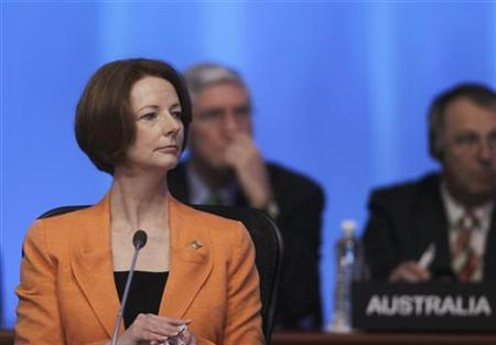 Australian Prime Minister Julia Gillard wait for the start of the first session of the G20 Summit in Los Cabos June 18, 2012. REUTERS/Edgard Garrido