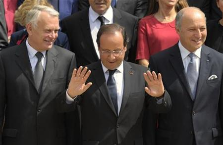 France's President Francois Hollande (C), Prime Minister Jean-Marc Ayrault (L) and Foreign Affairs minister Laurent Fabius (R) pose for the traditional family photo of the government after a minor government reshuffle outside the Elysee Palace in Paris July 4, 2012. REUTERS/Philippe Wojazer