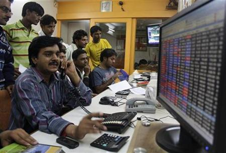 A trader works at a stock brokerage in the western Indian city of Ahmedabad November 26, 2010. REUTERS/Amit Dave/Files