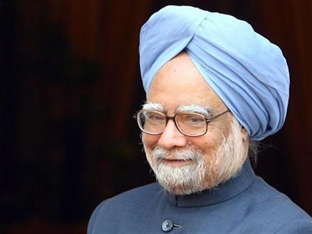 Prime Minister Manmohan Singh smiles before his meeting with Russian President Dmitry Medvedev in New Delhi December 5, 2008. REUTERS/B Mathur/Files