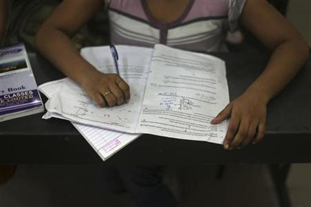 A student studies in a classroom at the Bansal Classes in Kota in Rajasthan, August 13, 2012. REUTERS/Ahmad Masood
