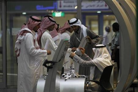 Jobseekers stand in line to talk with a recruiter at a booth at a job fair in Riyadh, January 29, 2012. REUTERS/Fahad Shadeed