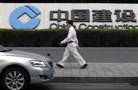 A man walks outside the China Construction Bank headquarters building in Beijing August 11, 2011. REUTERS/Jason Lee