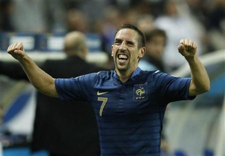 France's Franck Ribery celebrates after scoring the third goal for the team during their World Cup qualifying soccer match against Belarus in Saint-Denis, near Paris, September 11, 2012. REUTERS/Benoit Tessier