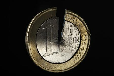 A damaged one Euro coin being held in a vise is pictured in this photo illustration taken in Warsaw September 13, 2012. Picture take September 13. REUTERS/Kacper Pempel