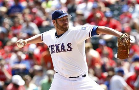 Texas Rangers starting pitcher Colby Lewis pitches against the Toronto Blue Jays in the fourth inning of their MLB American League baseball game in Arlington, Texas May 26, 2012. REUTERS/Mike Stone