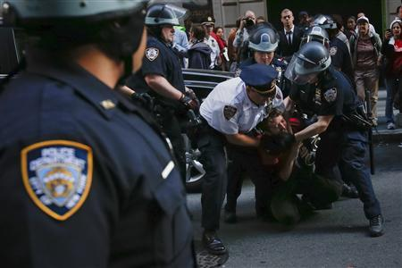 An Occupy Wall Street activist is arrested by policemen while marching past the corner of Wall St. and Williams St. on the one-year anniversary of the movement in New York on September 17, 2012. REUTERS/Adrees Latif