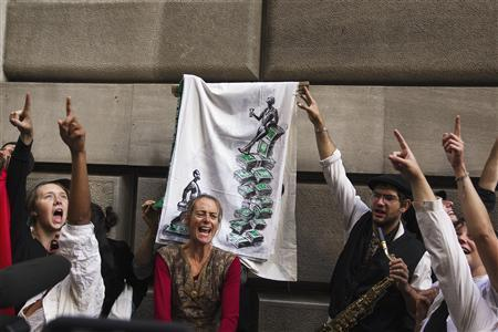 Occupy Wall Street activists demonstrate in the financial district during the one-year anniversary of the movement in New York, September 17, 2012. REUTERS/Lucas Jackson