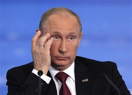 Russia's President Vladimir Putin attends a news conference at the Asia-Pacific Economic Cooperation (APEC) Summit in Vladivostok September 9, 2012. REUTERS/Sergei Karpukhin