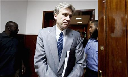 Christopher Stevens, the U.S. ambassador to Libya, leaves after a meeting with Libya's Justice Minister Ali Ashour discussing cooperation between the two countries on issues of human rights, in Tripoli June 27, 2012. Stevens and three embassy staff were killed late on September 11, 2012, as they rushed away from a consulate building in Benghazi, stormed by al Qaeda-linked gunmen blaming America for a film that they said insulted the Prophet Mohammad. Stevens was trying to leave the consulate building for a safer location as part of an evacuation when gunmen launched an intense attack, apparently forcing security personnel to withdraw. Picture taken June 27, 2012. REUTERS/Anis Mili (LIBYA - Tags: POLITICS CIVIL UNREST OBITUARY)