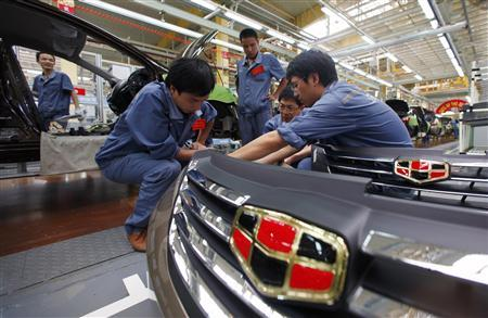 Employees check plastic bumpers along a Geely Automobile Corporation assembly line in Cixi, Zhejiang province in this June 21, 2012 file photo. REUTERS/Carlos Barria/Files
