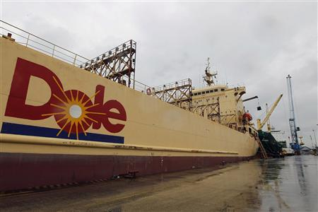 A Dole vessel transporting containers with boxes of bananas is anchored at Dole's Port in Guayaquil in this February 23, 2012 file photo. Struggling Dole Food Company Inc has agreed to sell its worldwide packaged foods and Asia fresh produce businesses to Japanese trading house Itochu Corp for $1.7 billion in cash. REUTERS/Guillermo Granja/Files