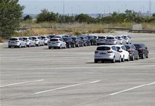 Cars rest at an almost-empty parking lot at the Ford Motor Company's factory in Almussafes near Valencia September 5, 2012. REUTERS/Heino Kalis