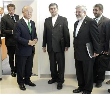 International Atomic Energy Agency (IAEA) Director General Yukiya Amano (L) meets Iran's Head of Atomic Energy Organization Fereydoon Abbasi-Davani (C) and Ali Asghar Soltanieh during the 56th IAEA General Conference at the UN headquarters in Vienna September 17, 2012. REUTERS/Herwig Prammer