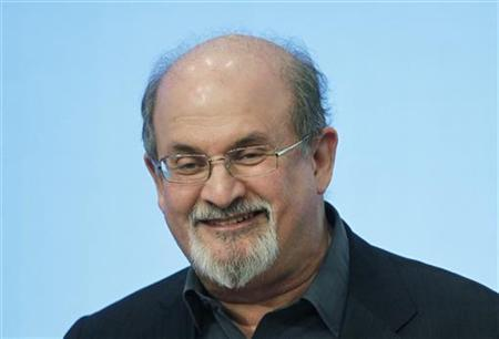 Author Salman Rushdie smiles while addressing the crowd at the 2012 Awards for Song Lyrics of Literary Excellence awarded to Chuck Berry and Leonard Cohen at the John F. Kennedy Presidential Library and Museum in Boston, Massachusetts February 26, 2012. REUTERS/Jessica Rinaldi