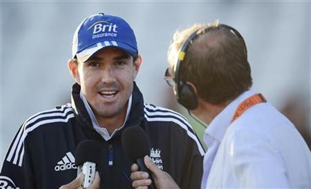 England's Kevin Pietersen is interviewed after the second test cricket match against South Africa was drawn, at Headingley cricket ground in Leeds August 6, 2012. REUTERS/Philip Brown/Files