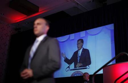 U.S. Republican presidential nominee and former Massachusetts Governor Mitt Romney is seen on a screen as U.S. Secret Service agents provide security at the U.S. Hispanic Chamber of Commerce meeting in Los Angeles, California, September 17, 2012. REUTERS/Jim Young