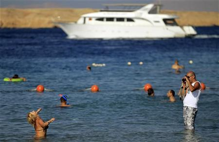 A tourist takes a photo at the Red Sea resort of Sharm el-Sheikh in the South Sinai governorate, about 550 km (342 miles) south of Cairo, July 12, 2012. REUTERS/Amr Abdallah Dalsh