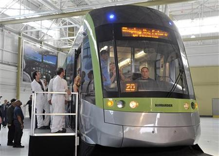 Employees and guests tour a Bombardier LRV train at the manufacturing facilities in Toronto May 29, 2012. REUTERS/ Mike Cassese