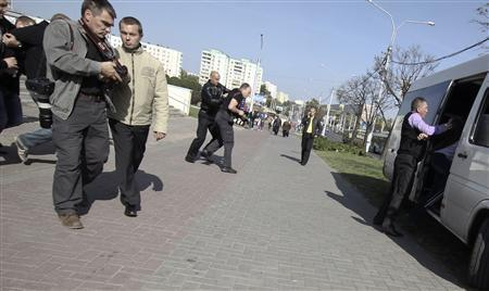 Members of law enforcement state agencies, dressed in plain clothes, detain journalists, including Reuters photographer Vasily Fedosenko (L), during an opposition picket demanding to boycott the upcoming parliamentary election in Minsk, September 18, 2012. REUTERS/Stringer