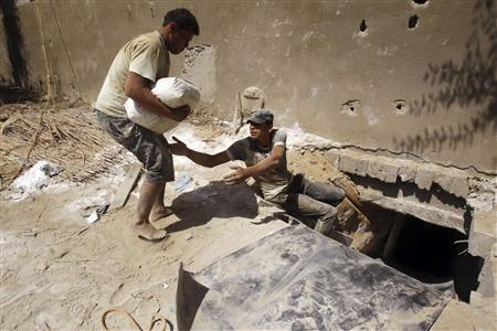 Palestinians smuggle cement outside a tunnel beneath the Egyptian-Gaza border in Rafah, in the southern Gaza Strip September 17, 2012. REUTERS/Ibraheem Abu Mustafa