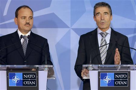 NATO Secretary General Anders Fogh Rasmussen speaks as Albania's President Bujar Nishani (L) looks on, during a news conference after their meeting at the Alliance's headquarters in Brussels September 18, 2012. REUTERS/Eric Vidal