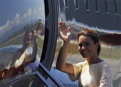 Britain's Catherine, Duchess of Cambridge, waves to locals as she boards a plane at Honiara International Airport September 18, 2012. REUTERS/Daniel Munoz