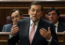 Spanish Prime Minister Mariano Rajoy answers a question during a parliamentary session at the Spanish parliament in Madrid September 12, 2012. REUTERS/Andrea Comas