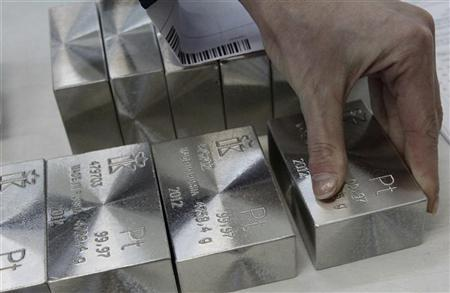 An employee sets out and sorts ingots of 99.97 percent pure platinum at the Krastsvetmet nonferrous metals plant in Russia's Siberian city of Krasnoyarsk April 12, 2012. REUTERS/Ilya Naymushin