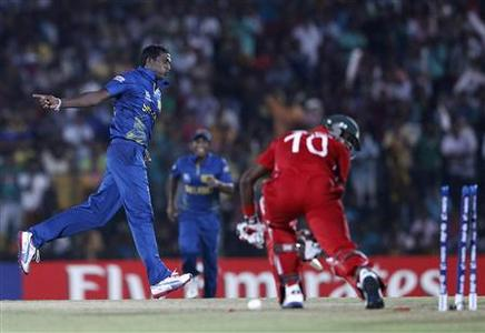 Sri Lanka's Ajantha Mendis (L) celebrates taking the wicket of Zimbabwe's Vusi Sibanda during their Twenty20 World Cup cricket match in Hambantota September 18, 2012. REUTERS/Dinuka Liyanawatte