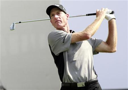 Jim Furyk of the U.S. hits a drive from the sixteenth tee during round one of the BMW Championship golf tournament in Carmel, Indiana September 6, 2012. REUTERS/Brent Smith