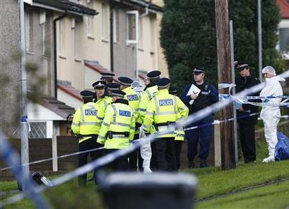 Police and forensic officers gather at the scene where two female police officers were killed in Hattersley near Manchester, northern England September 18, 2012. REUTERS/Darren Staples