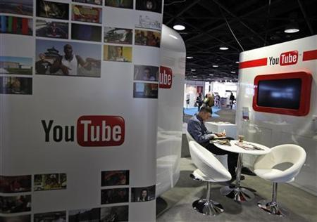 A visitor sits at the YouTube stand during the International Record Music Publishing and Video Music Market (MIDEM) in Cannes January 29, 2012. REUTERS/Eric Gaillard