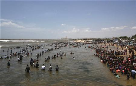 Demonstrators stand in the waters of the Bay of Bengal as they shout slogans during a protest near Kudankulam nuclear power project in the southern Indian state of Tamil Nadu September 13, 2012. REUTERS/Adnan Abidi