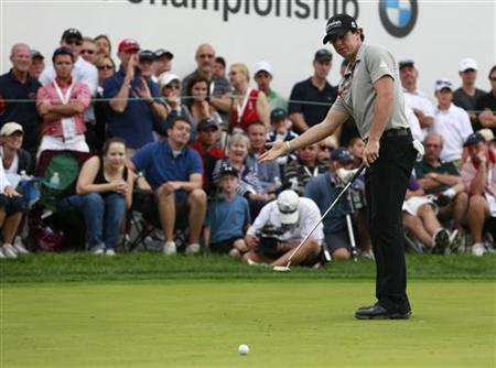 Rory McIlroy of Northern Ireland reacts after missing a putt on the 15th green during the final round of the PGA Championship golf tournament in Carmel, Indiana September 9, 2012. REUTERS/Brent Smith