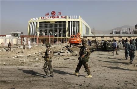 Nato soldiers arrive at the site of a suicide bomb attack in Kabul September 18, 2012. Afghan insurgent group Hezb-e-Islami claimed responsibility on Tuesday for the suicide bomb attack on a minivan carrying foreign workers that killed 12 people saying it was retaliation for a film mocking the Prophet Mohammad. REUTERS/Mohammad Ismail