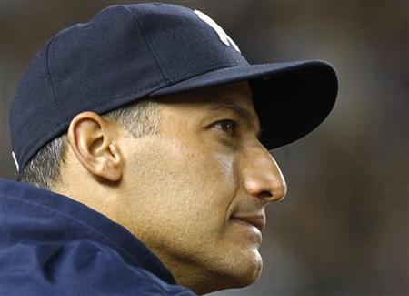 New York Yankees starting pitcher Andy Pettitte looks on from the dugout against the Atlanta Braves during the ninth inning of their MLB Interleague baseball game at Yankee Stadium in New York, June 18, 2012. REUTERS/Adam Hunger
