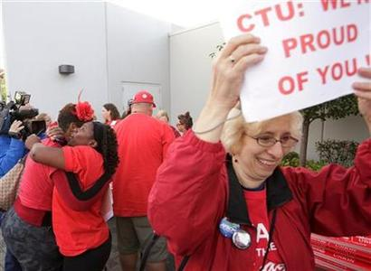 Jacqueline Robinson (2nd L) and other members of the Chicago Teachers Union celebrate the end of their strike in Chicago September 18, 2012. Chicago Teachers Union leaders voted on Tuesday to suspend a strike that closed the nation's third-largest school district for more than a week, ending a confrontation with Mayor Rahm Emanuel that focused national attention on how to reform failing urban schools. REUTERS/John Gress