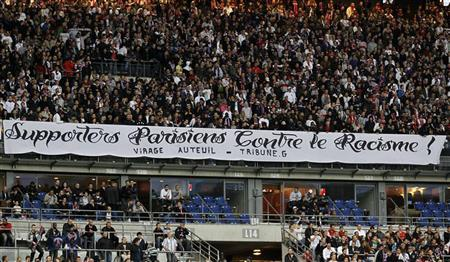 A banner reading ''Paris supporters against racism'' is displayed at the Stade de France stadium during the French Cup final soccer match between Monaco and Paris Saint-Germain in Saint-Denis, May 1, 2010. REUTERS/Charles Platiau