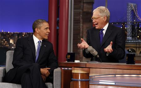 Seated with talk show host David Letterman, U.S. President Barack Obama makes an appearance on the ''Late Show with David Letterman'' at the Ed Sullivan Theater in New York City September 18, 2012. REUTERS/Kevin Lamarque