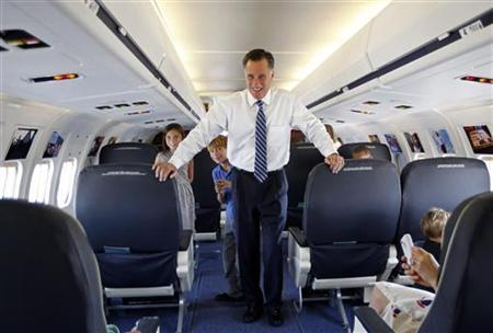 U.S. Republican presidential nominee and former Massachusetts Governor Mitt Romney takes his grandson Wyatt (C) and granddaughter Gracie on a tour of his campaign plane in Salt Lake City, Utah September 18, 2012. REUTERS/Jim Young