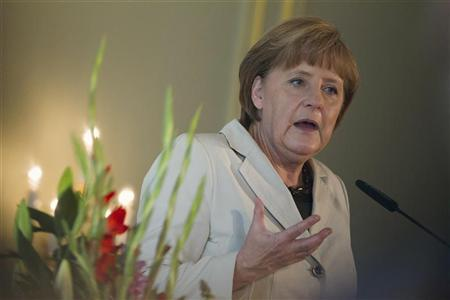 German Chancellor Angela Merkel speaks at a conference of the German Foundation of Family Businesses in Berlin June 15, 2012. REUTERS/Thomas Peter